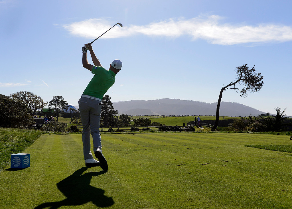 . Troy Merritt watches his tee shot from the 5th hole at the Pebble Beach Golf Links during the final round of the AT&T Pebble Beach Pro-Am on Sunday, Feb. 11, 2018. (Vern Fisher - Monterey Herald)
