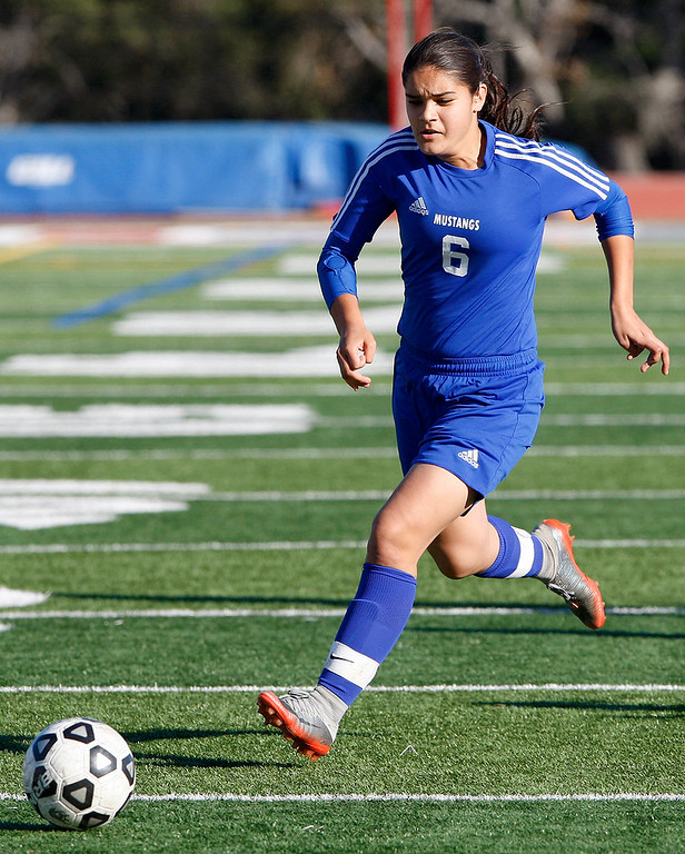. King City High\'s Jatziri Gaxiola (6) dribbles with the ball during their match against Carmel High on Wednesday, 14, 2018.  (Vern Fisher - Monterey Herald)