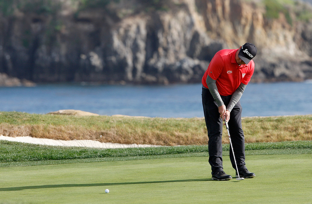 . Ted Potter Jr. putts on the 17th hole at the Pebble Beach Golf Links during the final round of the AT&T Pebble Beach Pro-Am on Sunday, Feb. 11, 2018.  Potter went on to win the tournament by three strokes with a -17.  (Vern Fisher - Monterey Herald)