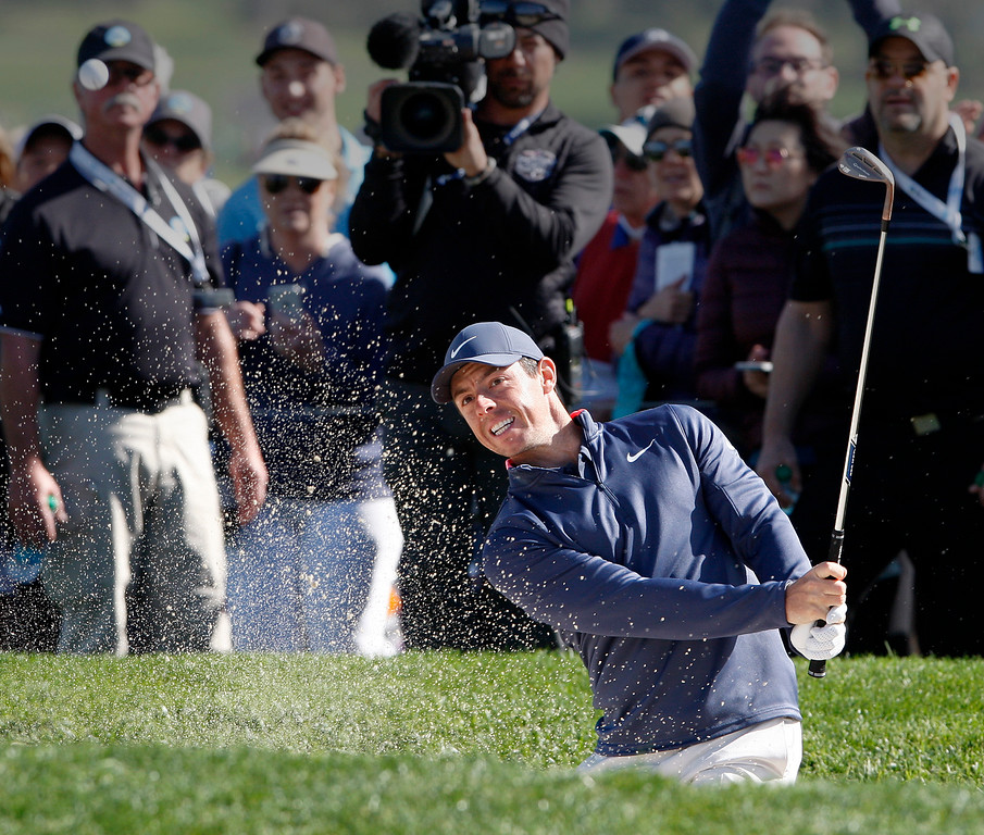 . Rory McIlroy hits from a bunker on the 6th hole at the Pebble Beach Golf Links during the third round of the AT&T Pebble Beach Pro-Am on Saturday, Feb. 10, 2018.  (Vern Fisher - Monterey Herald)