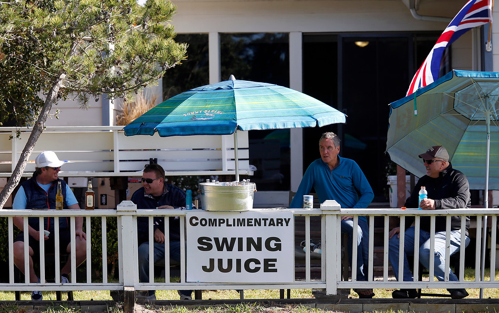 . Golf fans on the third tee offer drinks to passing fans at Monterey Peninsula Country Club during the third round of the AT&T Pebble Beach Pro-Am in Pebble Beach, Calif. on Saturday February 10, 2018. (David Royal/Herald Correspondent)