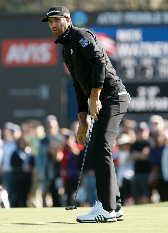 . Dustin Johnson reacts to a missed putt on the third hole at the Pebble Beach Golf Links during the third round of the AT&T Pebble Beach Pro-Am on Saturday, Feb. 10, 2018.  (Vern Fisher - Monterey Herald)