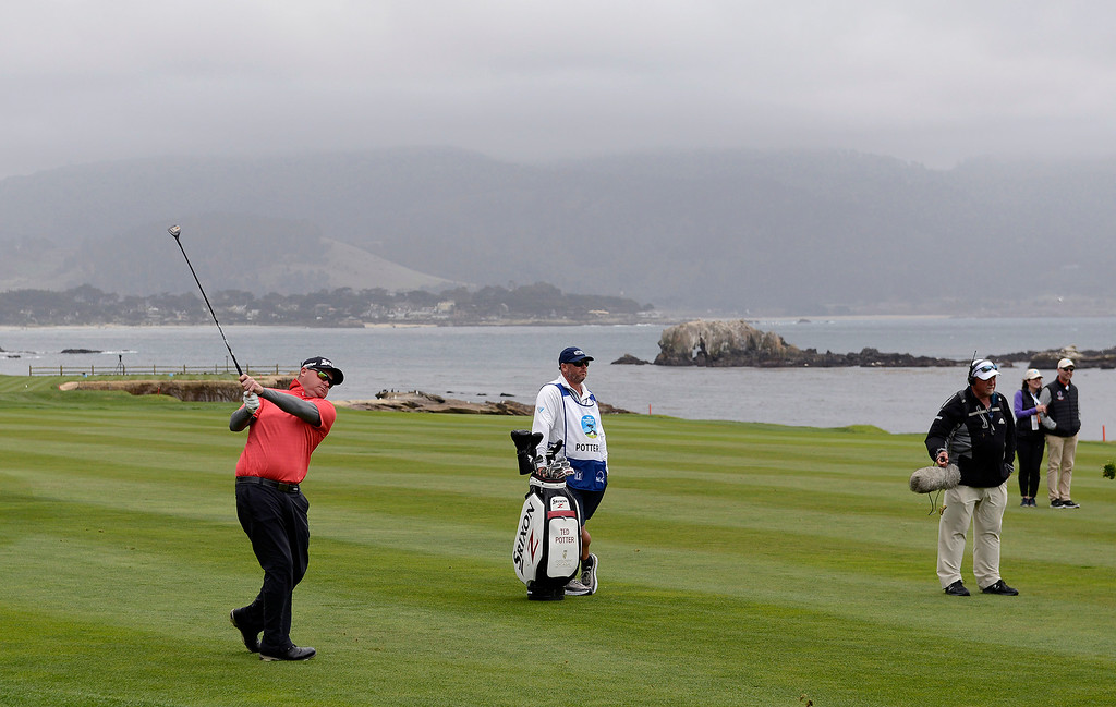 . Ted Potter Jr. hits his second shot from the 18th hole at the Pebble Beach Golf Links during the final round of the AT&T Pebble Beach Pro-Am on Sunday, Feb. 11, 2018.  Potter went on to win the tournament by three strokes with a -17.   (Vern Fisher - Monterey Herald)