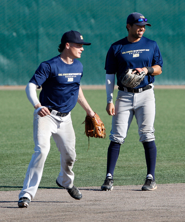 . CSU Monterey Bay baseball players Kyle Czaplak and Myles Hager at practice on Friday, Jan. 26, 2018.  (Vern Fisher - Monterey Herald)