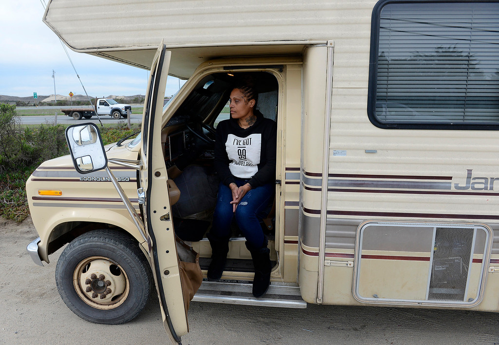 . Deborah Gabot sits in her recreational vehicle as she contemplates her next move after Monterey County Sheriffs deputies talked with homeless people ordering them to remove their parked vehicles from Monte Road north of Marina on Monday, Jan. 29, 2018.  (Vern Fisher - Monterey Herald)