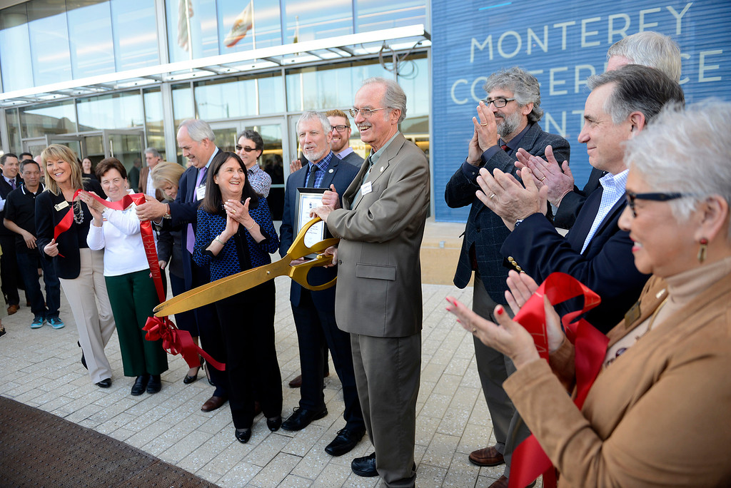 . Monterey mayor Clyde Roberson cuts the ribbon at the grand opening ribbon cutting of the Monterey Conference Center on Wednesday, Jan. 31, 2018.  (Vern Fisher - Monterey Herald)