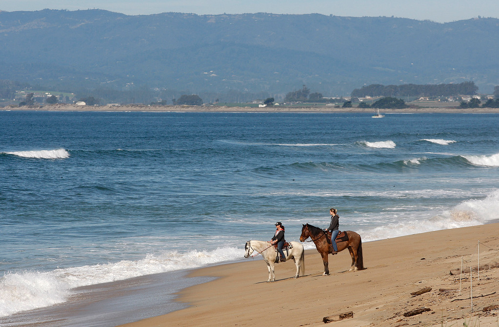 . Two women horseback riding at Salinas River State Beach south of Moss Landing on Thursday, Feb. 1, 2018.  (Vern Fisher - Monterey Herald)