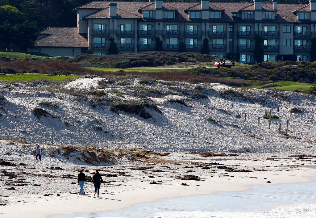 . Beach goers at Asilomar State Beach in Pacific Grove on Thursday, Feb. 1, 2018.  (Vern Fisher - Monterey Herald)
