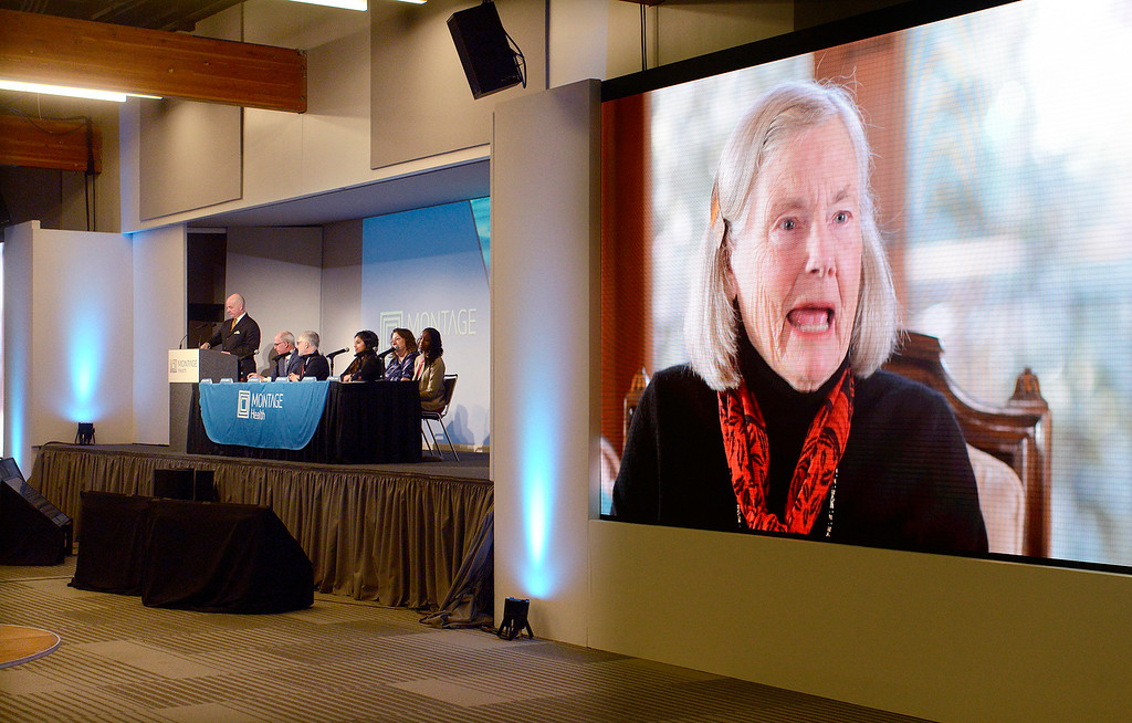 ". Roberta ""Bertie\"" Buffett Elliott, younger sister of Warren Buffett plays on video during a press conference by Montage Health announcing a $105.8 million donation to Montage Health Foundation on Tuesday, Jan. 30, 2018.   The gift will be devoted exclusively to creating an innovative approach to child and adolescent behavioral health. Elliott chose the name Ohana � Hawaiian for �family�.  (Vern Fisher - Monterey Herald)"