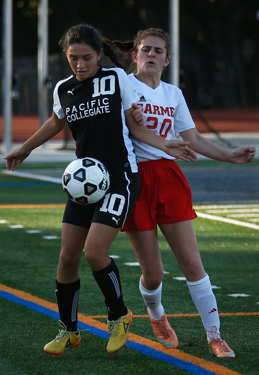 . PCS\' Roxanna Ortiz and Carmel\'s Hannah Ryan battle for a loose ball during girls soccer at Carmel High School on Wednesday January 31, 2018. (David Royal/Herald Correspondent)