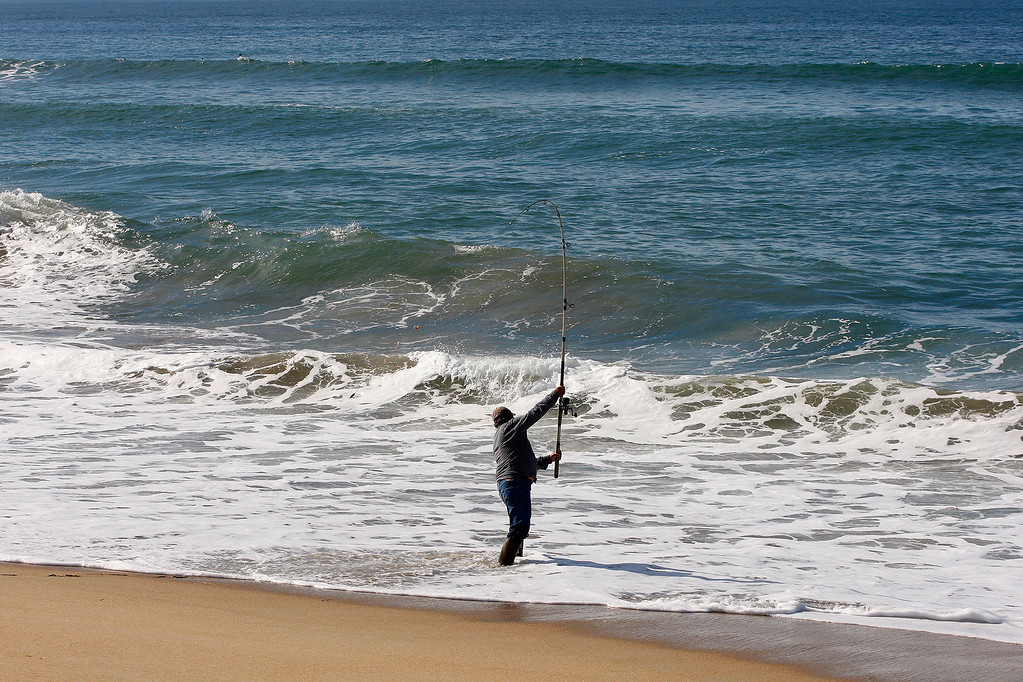 . A man fishes at Salinas River State Beach south of Moss Landing on Thursday, Feb. 1, 2018.  (Vern Fisher - Monterey Herald)