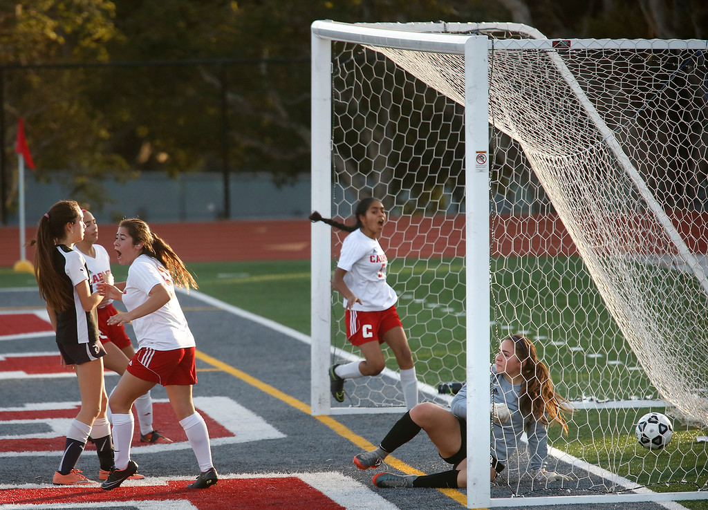 . PCS Goalie Valentina Vanos lies on the ground as Carmel players celebrate a second half goal by Jessica Bartlett during girls soccer at Carmel High School on Wednesday January 31, 2018. (David Royal/Herald Correspondent)
