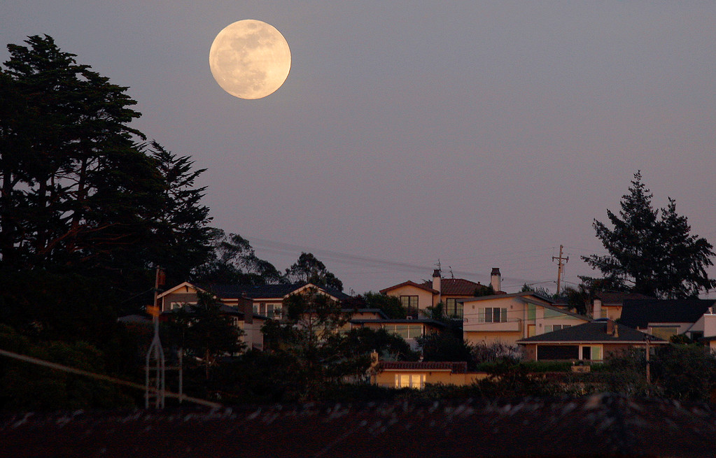 . The super blue blood moon rises over Aptos on Tuesday, Jan. 30, 2018.  (Vern Fisher - Monterey Herald)