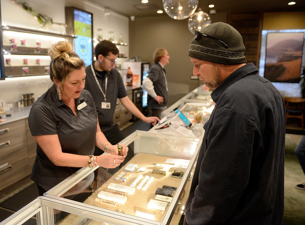 . Cannabis consultant Lisa Davis helps customer Rudy Bucher during the first day of recreational sales for the Big Sur Canna Botanicals store in the Carmel Rancho Center in Carmel on Friday, Jan. 5, 2018.  (Vern Fisher - Monterey Herald)