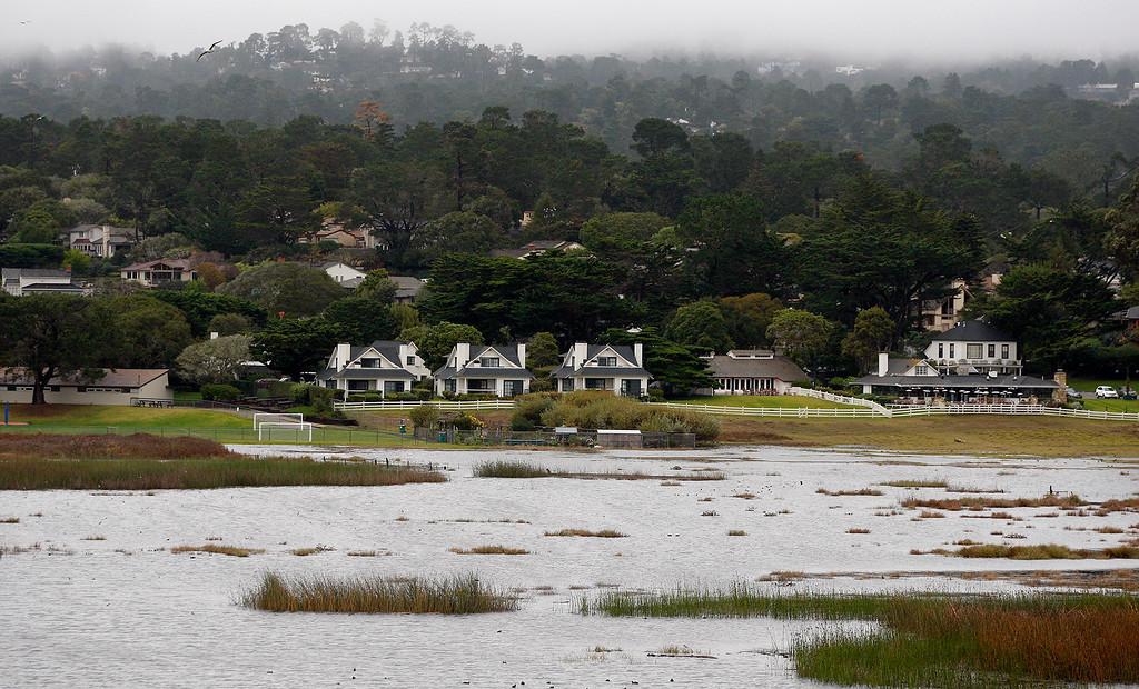 . Looking towards Mission Ranch and the Carmel River Lagoon on Tuesday, Jan. 9, 2018.  The Monterey County Resource Management Agency brought in special crews to work at the Carmel Lagoon area to lower and contour the sandbar at Carmel River State Beach as part of its lagoon management plan.  (Vern Fisher - Monterey Herald)