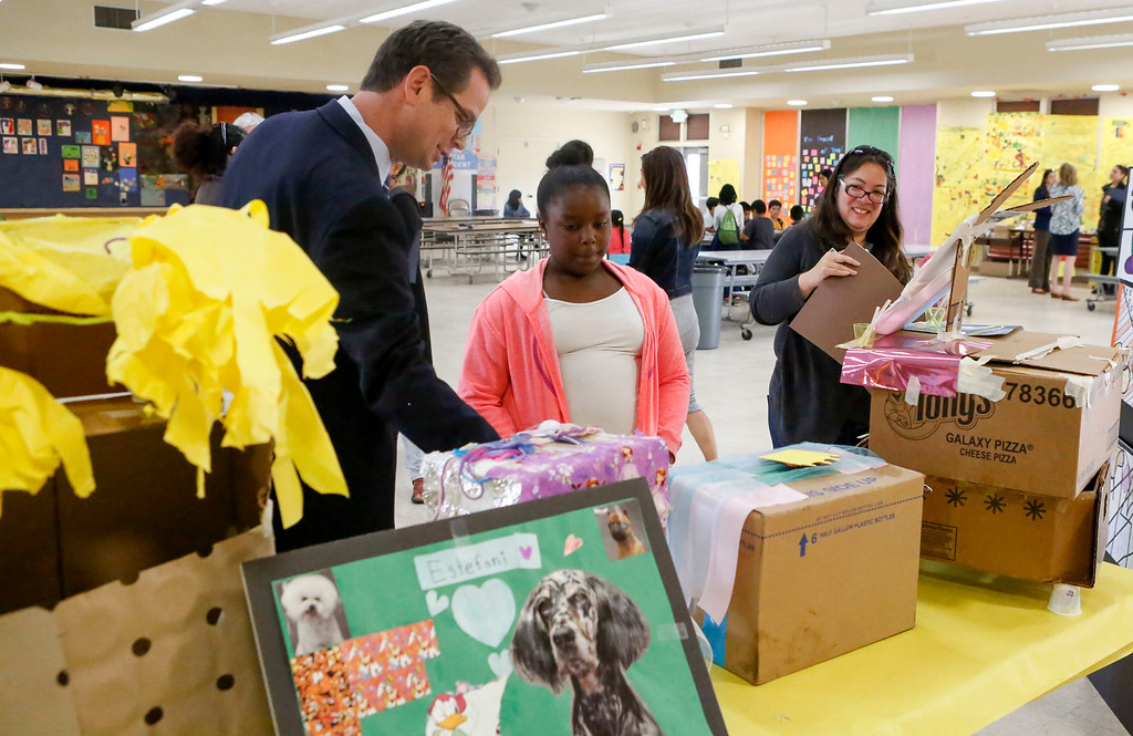 """. MPUSD Superintendent Dr. PK Diffenbaugh looks over an art project by Za\'Riyah Murphy, 9, as she details her piece title \""""Princess\"""" during a visit by a group of district educators at Crumptom Elementary School on Friday, July 14, 2017 in Marina, Calif. (Vernon McKnight/Herald Correspondent)"""