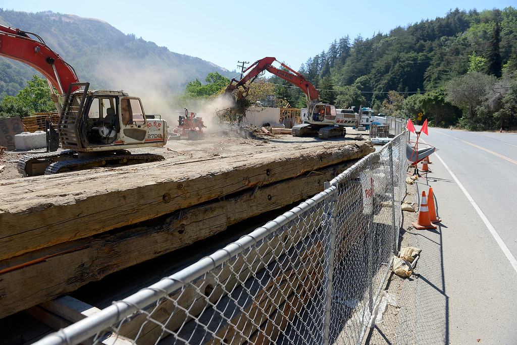 . Work crews remove debris from the north side at the Pfeiffer Canyon Bridge consturction site on Highway One in Big Sur on Wednesday, July 19, 2017.  (Vern Fisher - Monterey Herald)