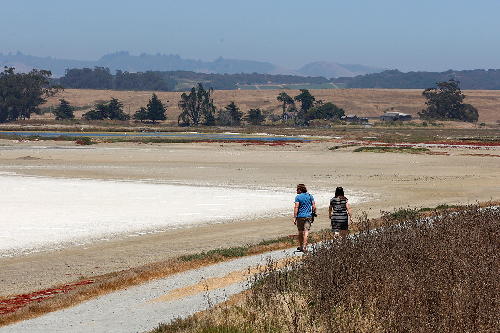 . Two people enjoy the nice weather at the Elkhorn Slough in Moss Landing on Tuesday, July 18, 2017.  (Vern Fisher - Monterey Herald)