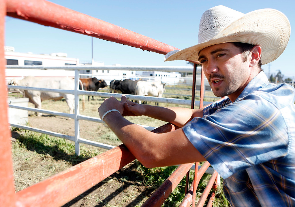 . Brandon Davis stands near a pen full of bulls prior to competing in the Professional Bull Riding event at the Salinas Rodeo grounds on Wednesday July 19, 2017. (David Royal/Herald Correspondent)
