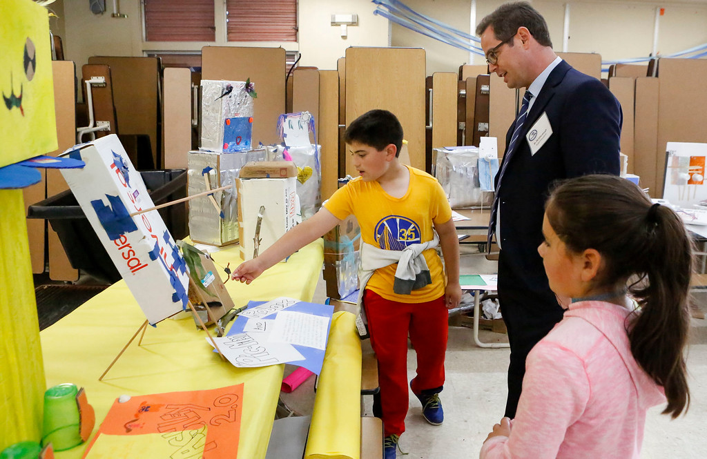 """. MPUSD Superintendent Dr. PK Diffenbaugh looks over an art project by Davey Rodriguez, 9, as he details his piece title \""""The Pike-Men\"""" as Catherine Rodriguez, 8, looks on during a visit by a group of district educators at Crumptom Elementary School on Friday, July 14, 2017 in Marina, Calif. (Vernon McKnight/Herald Correspondent)"""