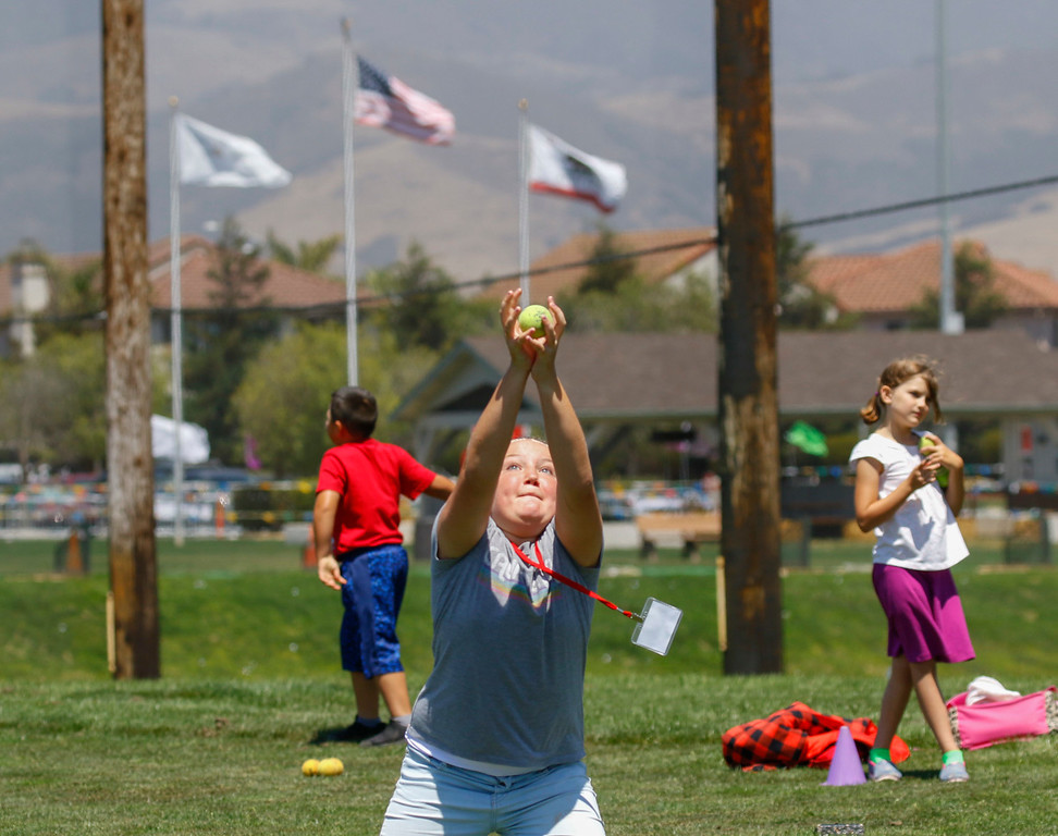 . Sydney Weaver, 12, catches a tennis ball before learning to hit a chip shot during The First Tee of Monterey County Summer Camp 2017 at Twin Creeks Golf Course on Monday, July 17, 2017 in Salinas, Calif. (Vernon McKnight/Herald Correspondent)