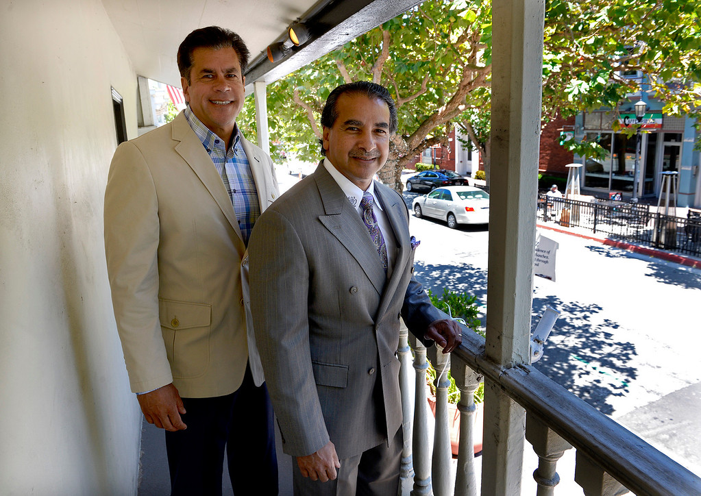 . Sabu Shake Jr. with Chris Shake on the balcony of their newly purchased building on 414 Alvarado Street in Monterey on Tuesday, July 18, 2017.  Chris and Sabu Jr. Shake bought their first downtown Monterey property - the historical Sanchez Adobe, which for years was The Attic on Alvarado Street. They plan to turn it into a restaurant or bakery.  (Vern Fisher - Monterey Herald)