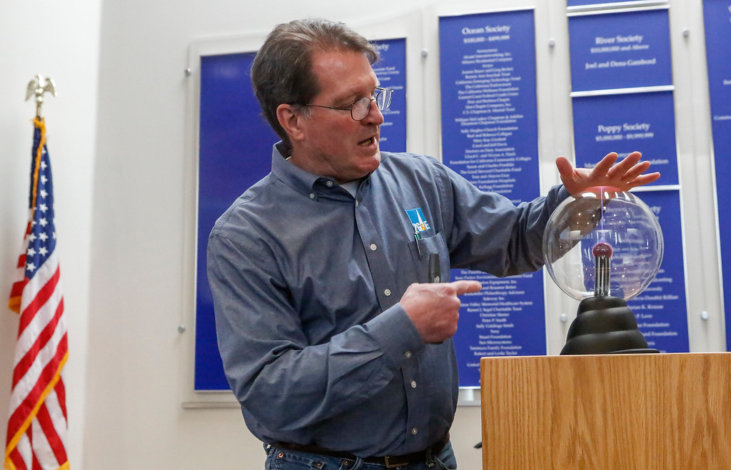 . Dane Lobb, Damage Prevention Awareness Specialist at PG&E, demonstrates using a plasma globe how electrical currents works when you get too close to a downed power line during a California State University�s Emergency Managers Conference at the Alumni Visitors Center at CSU Monterey Bay on Friday, July 14, 2017 in Seaside, Calif. (Vernon McKnight/Herald Correspondent)