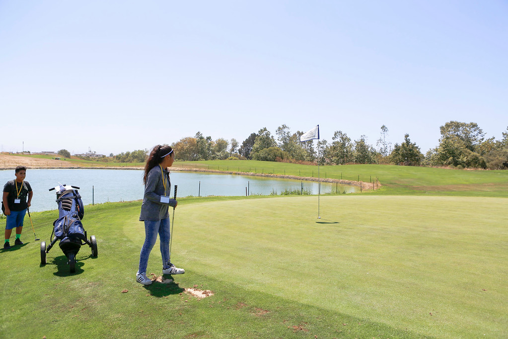 . Dayanara Beltran, 12, tracks her ball as she goes on to sink a putt shot during The First Tee of Monterey County Summer Camp 2017 at Twin Creeks Golf Course on Monday, July 17, 2017 in Salinas, Calif. (Vernon McKnight/Herald Correspondent)
