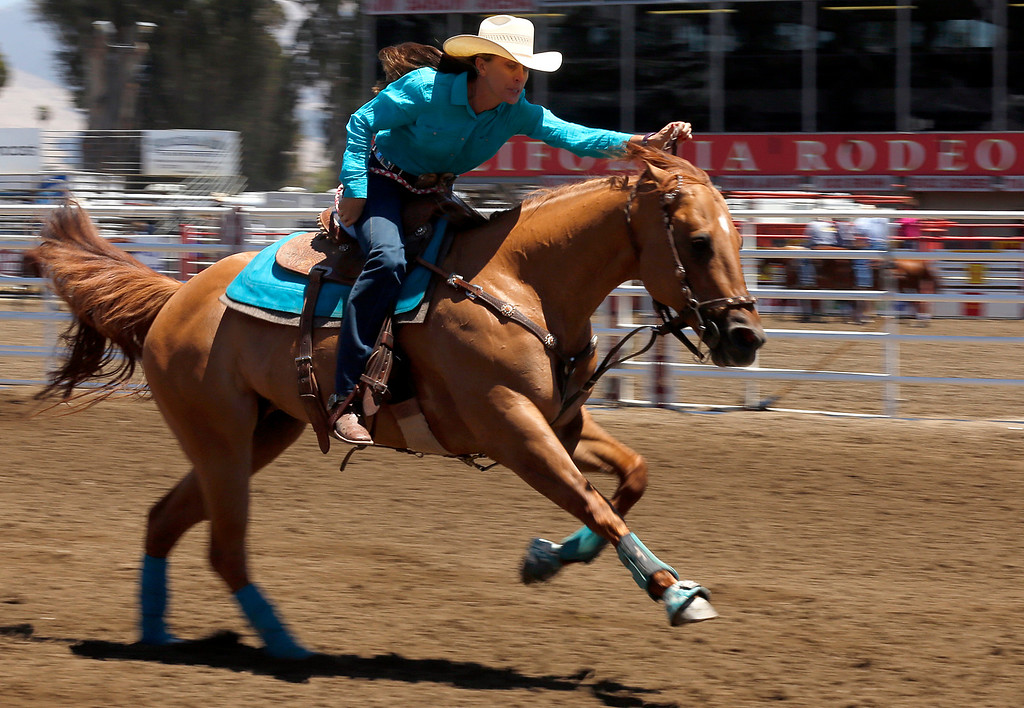 . A barrel racer charges to the finish line while competing during the California Rodeo Salinas at the rodeo grounds in Salinas on Thursday July 20, 2017. (David Royal/Herald Correspondent)