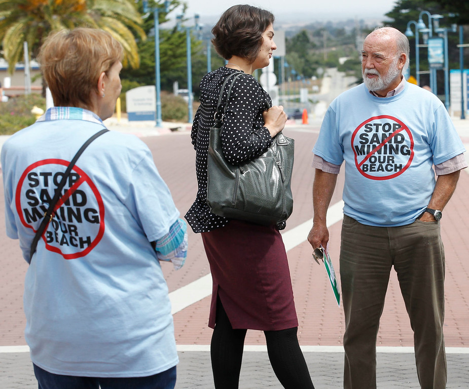 . A number of supporters of the Coastal Commission\'s proposed settlement to remove the CEMAX sand mining plant in Marina rally outside the World Theater at CSU Monterey Bay on Thursday, July 13, 2017 in Seaside, Calif. (Vernon McKnight/Herald Correspondent)