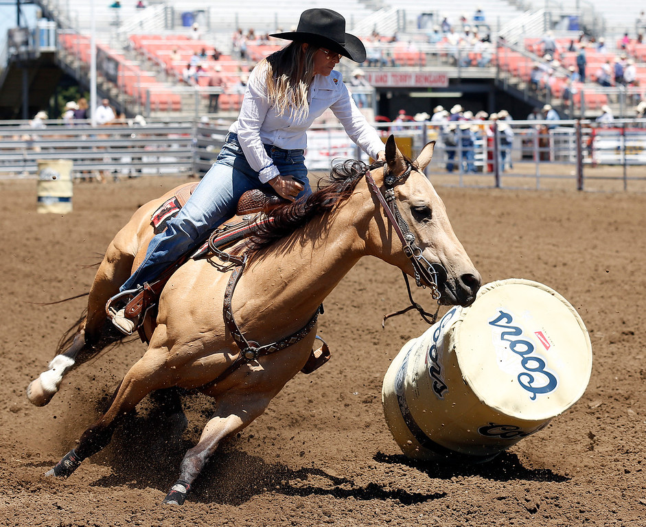 . A barrel racer knocks over a barrel while competing during the California Rodeo Salinas at the rodeo grounds in Salinas on Thursday July 20, 2017. (David Royal/Herald Correspondent)