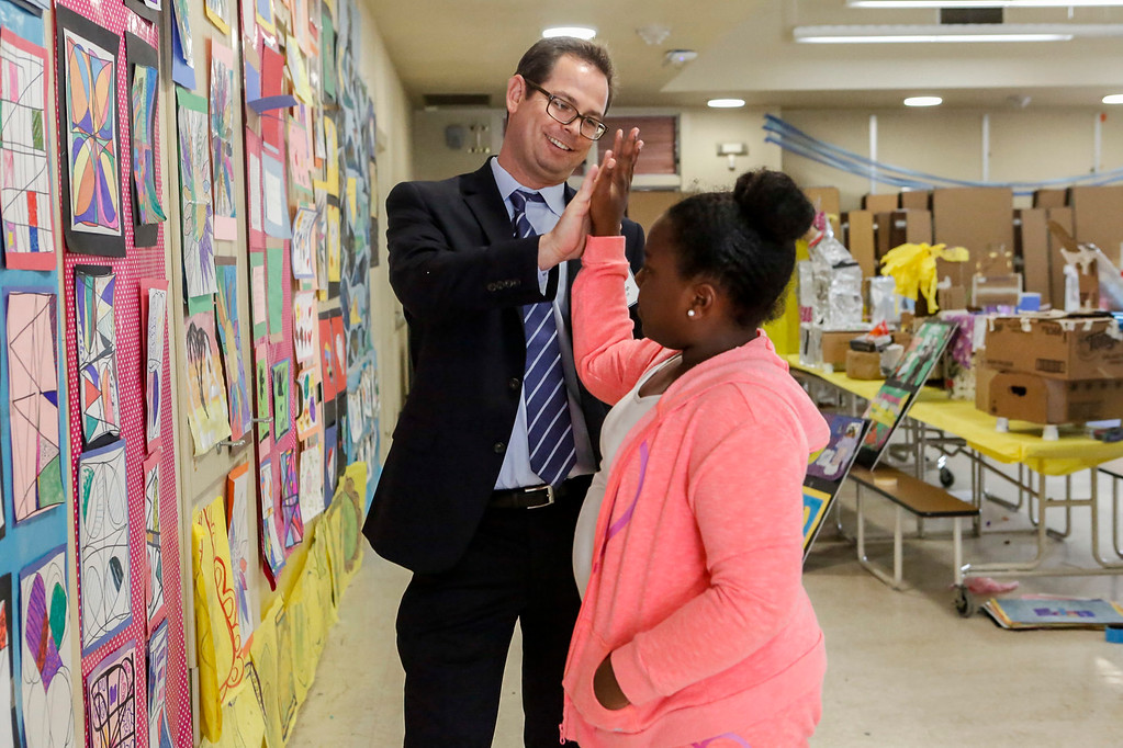 . MPUSD Superintendent Dr. PK Diffenbaugh gives Za\'Riyah Murphy, 9, a hi-five during a visit by a group of district educators at Crumptom Elementary School on Friday, July 14, 2017 in Marina, Calif. (Vernon McKnight/Herald Correspondent)