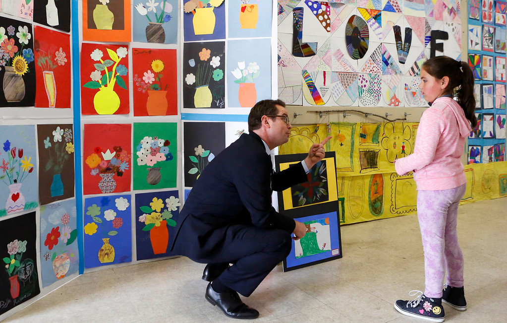 . MPUSD Superintendent Dr. PK Diffenbaugh chats with Catherine Rodriguez, 8, about her art summer art project  at Crumptom Elementary School on Friday, July 14, 2017 in Marina, Calif. (Vernon McKnight/Herald Correspondent)