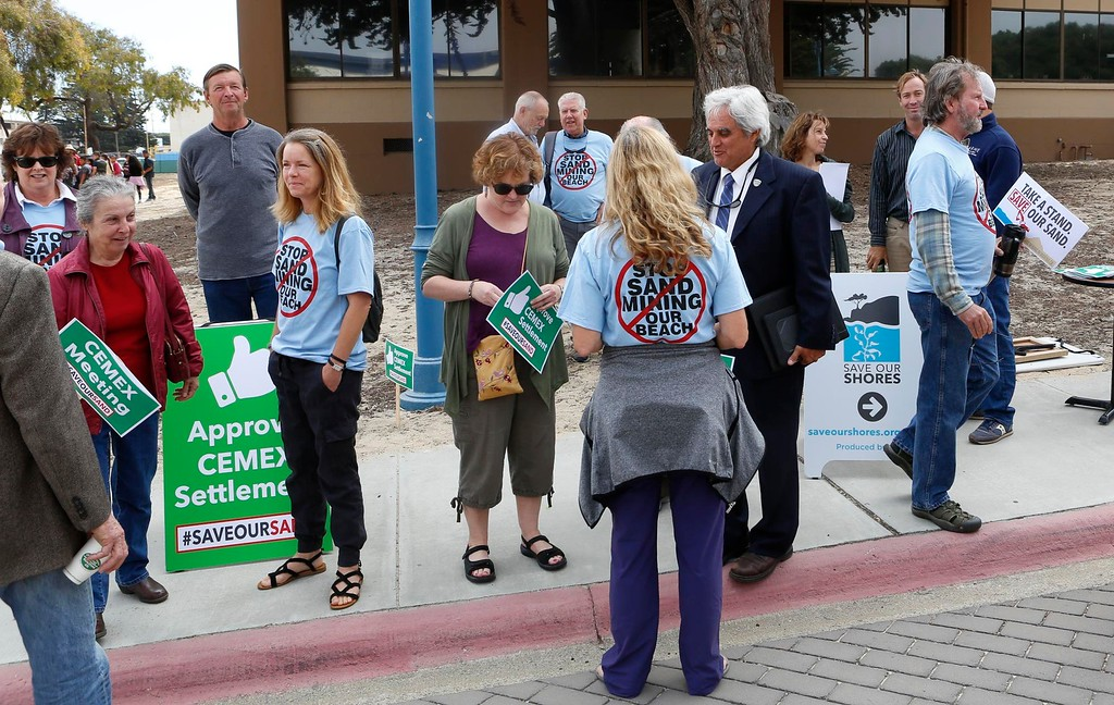 . A number of supporters of the Coastal Commission\'s proposed settlement to remove the CEMAX sand mining plant in Marina including Marina mayor Bruce Delgado, center right, rally outside the World Theater at CSU Monterey Bay on Thursday, July 13, 2017 in Seaside, Calif. (Vernon McKnight/Herald Correspondent)