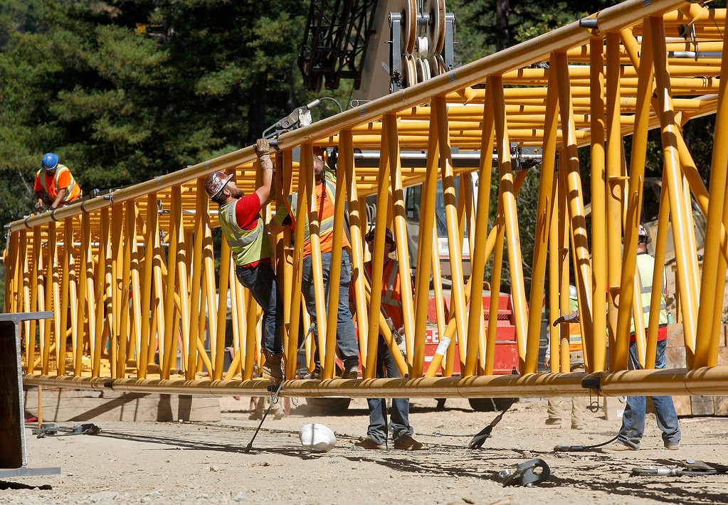 . Crane engineers prepare the large crane to haul the steel girders at the Pfeiffer Canyon Bridge consturction site on Highway One in Big Sur on Wednesday, July 19, 2017.  (Vern Fisher - Monterey Herald)
