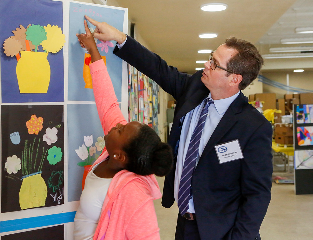 . MPUSD Superintendent Dr. PK Diffenbaugh and Za\'Riyah Murphy, 9, point out the spelling of her name on her art project during a visit by a group of district educators at Crumptom Elementary School on Friday, July 14, 2017 in Marina, Calif. (Vernon McKnight/Herald Correspondent)