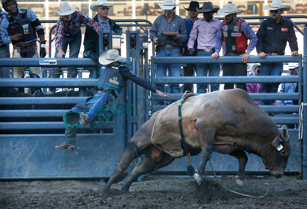 . Lindomar Lino of Brazil gets ejected from his bull while competing in the Professional Bull Riding event at the Salinas Rodeo grounds on Wednesday July 19, 2017. (David Royal/Herald Correspondent)