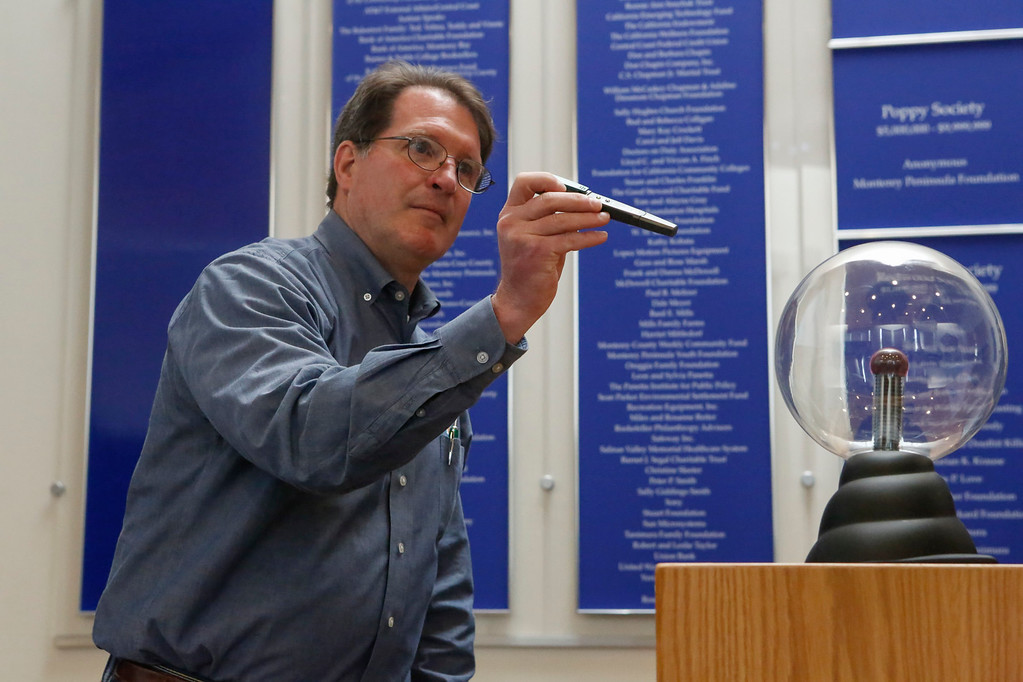 . Dane Lobb, Damage Prevention Awareness Specialist at PG&E, demonstrates using audio and a plasma globe how electrical currents works and how close to a downed power line can be and still be a conductor during a California State University�s Emergency Managers Conference at the Alumni Visitors Center at CSU Monterey Bay on Friday, July 14, 2017 in Seaside, Calif. (Vernon McKnight/Herald Correspondent)