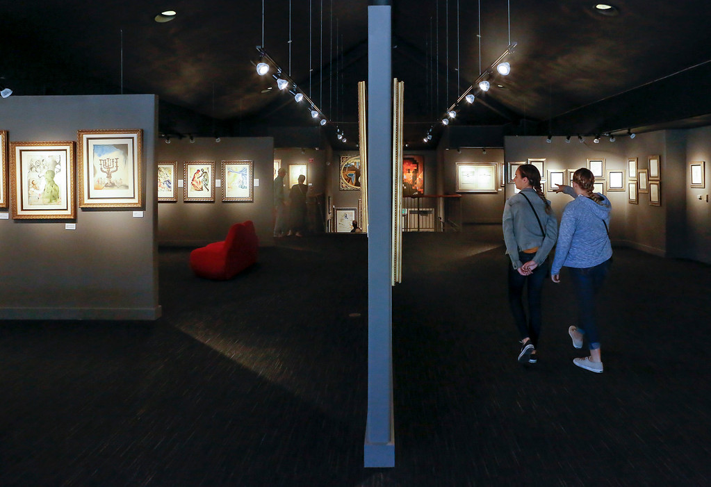 . Visitors walk through one of exhibits of Salvador Dalí during Dalí17\'s one year anniversary celebration of the exhibit on display inside the Stanton Center at the Custom House Plaza on Saturday, July 15, 2017 in Monterey, Calif. (Vernon McKnight/Herald Correspondent)