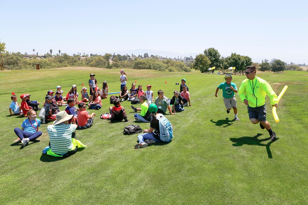 . Brandon Martinez, one of the camp\'s lead coaches is chased by first-time camper, Dominik Torres 9, in a game of Duck Duck Goose during The First Tee of Monterey County Summer Camp 2017 at Twin Creeks Golf Course on Monday, July 17, 2017 in Salinas, Calif. (Vernon McKnight/Herald Correspondent)
