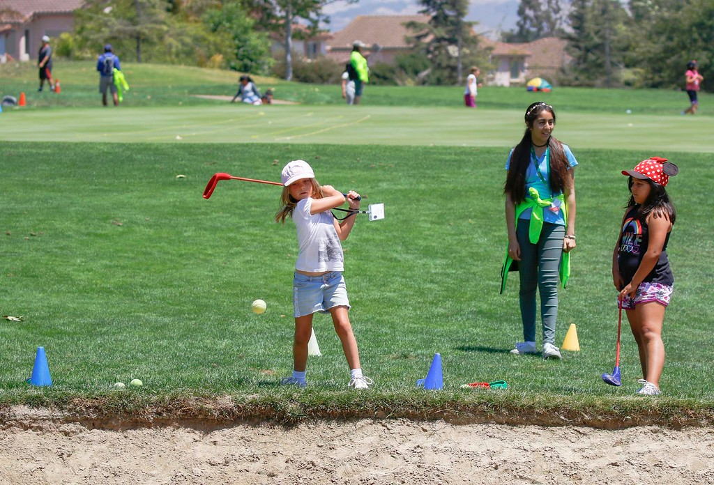 . Lily Weaver, 7, practices driving using a tennis ball during The First Tee of Monterey County Summer Camp 2017 at Twin Creeks Golf Course on Monday, July 17, 2017 in Salinas, Calif. (Vernon McKnight/Herald Correspondent)