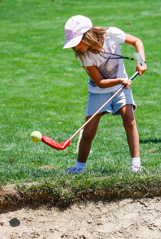 . Lily Weaver, 7, practices driving the ball using a tennis ball during The First Tee of Monterey County Summer Camp 2017 at Twin Creeks Golf Course on Monday, July 17, 2017 in Salinas, Calif. (Vernon McKnight/Herald Correspondent)