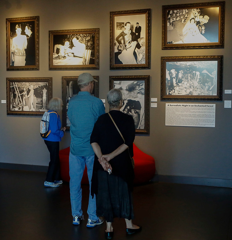 . Visitors look at portraits from Salvador Dalí\'s A Surrealistic Night in an Enchanted Forest collection during Dalí17\'s one year anniversary celebration of the exhibit on display inside the Stanton Center at the Custom House Plaza on Saturday, July 15, 2017 in Monterey, Calif. (Vernon McKnight/Herald Correspondent)