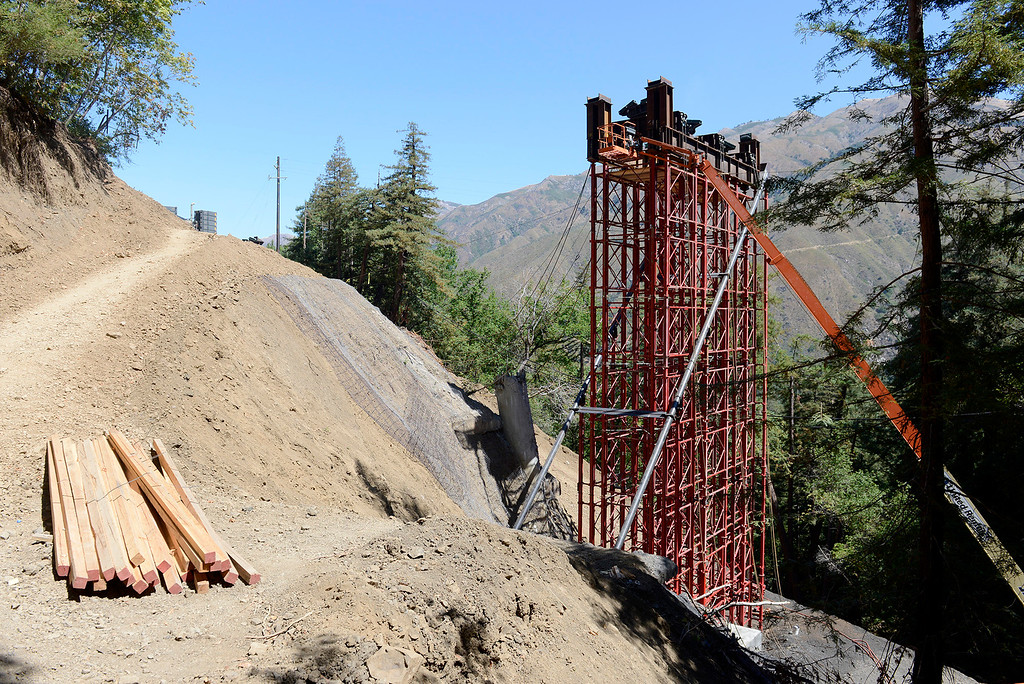 . Steel workers work 320 feet above the Pfeiffer Canyon at the Pfeiffer Canyon Bridge consturction site on Highway One in Big Sur on Wednesday, July 19, 2017.  (Vern Fisher - Monterey Herald)