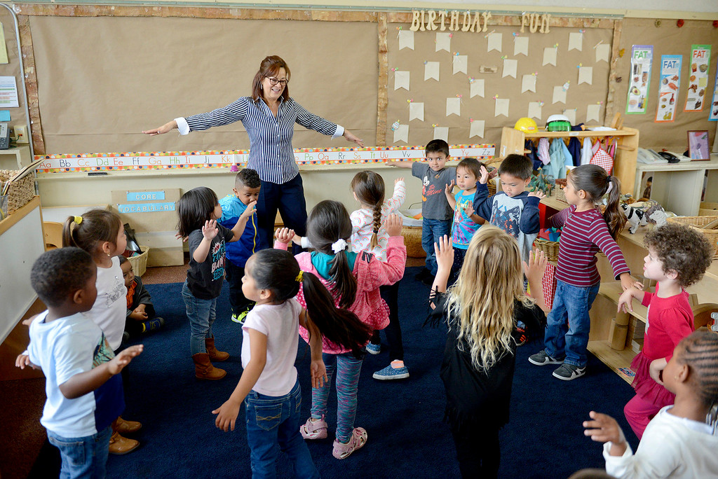 . Teacher Leticia Meraz with her pre-kindergarten students at the Marina Child Development Center in Marina on Monday, July 24, 2017.   (Vern Fisher - Monterey Herald)