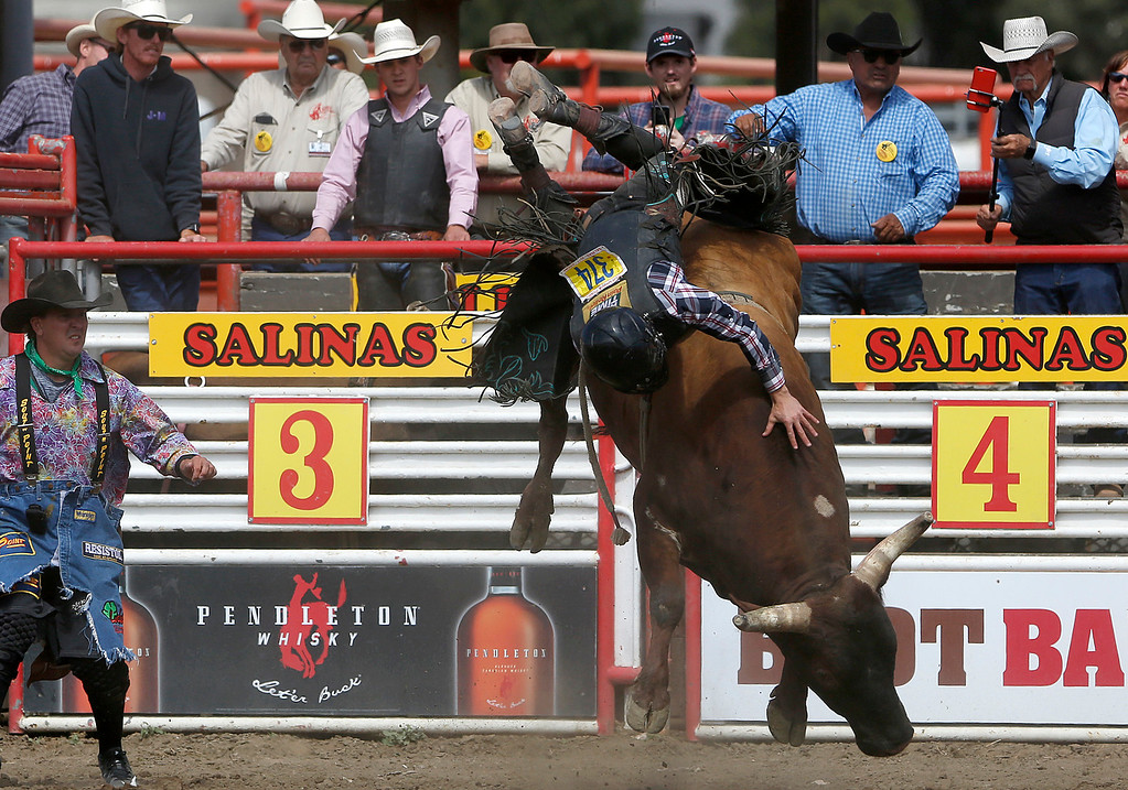 . Tristan Maze of Bryan, TX gets pitched while bull riding during the finals of the California Rodeo Salinas at the rodeo grounds in Salinas on Sunday July 23, 2017. (David Royal/Herald Correspondent)