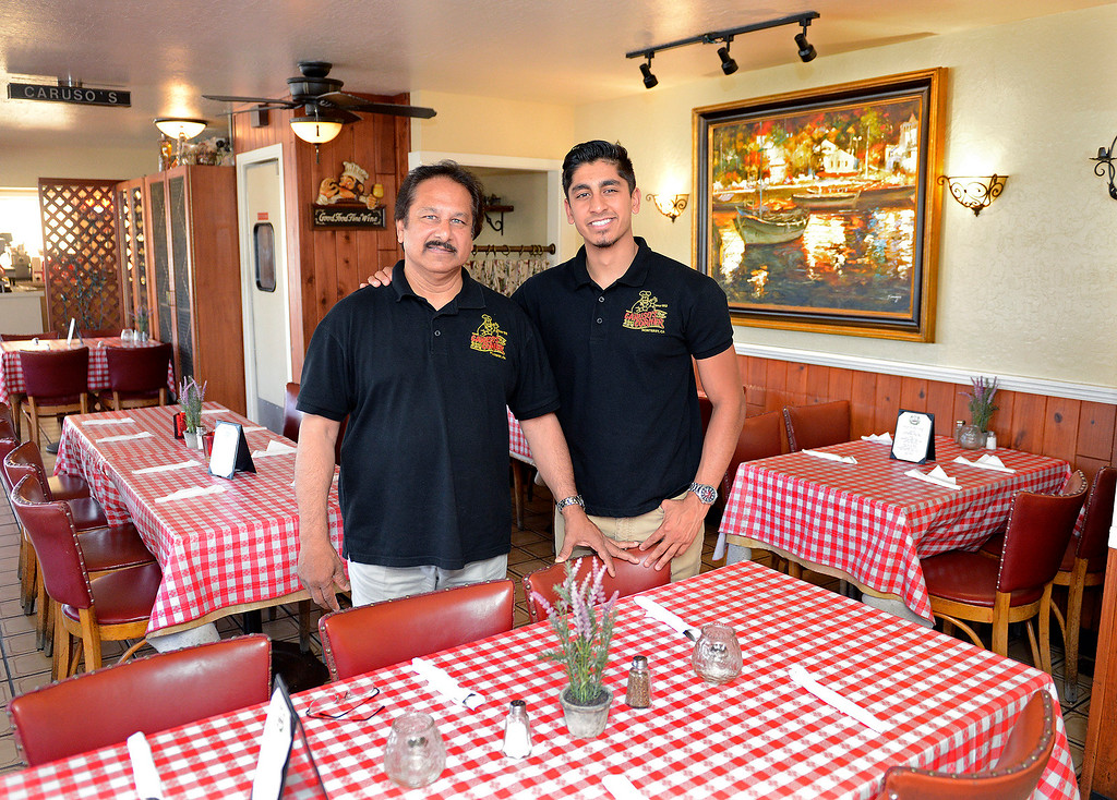 . Caruso\'s Corner Restaurant owner Richard Singh with his son Shivan Singh in Caruso\'s Corner Restaurant on North Fremont St. in Monterey on Tuesday, July 25, 2017.   (Vern Fisher - Monterey Herald)