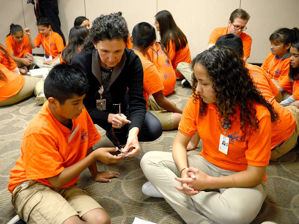 . Dr. Nadine Semer, MD works with Ronaldo Corona and Melisa Garcia who were participating in Salinas Valley Memorial Healthcare System�s (SVMHS) Medical Adventure Camp on Tuesday, July 25, 2017.  The students received hands on lesson on suturing. The class was taught by Dr. Semer who is a plastic surgeon currently a member of the Palliative Care team at SVMHS. The campers will learn about different types of sutures, techniques and will be able to perform sutures using foam and needleless sutures.  (Vern Fisher - Monterey Herald)