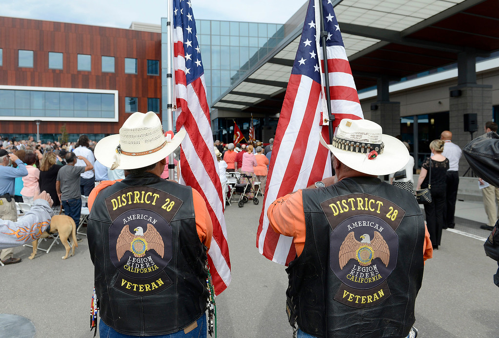 . Members of the American Legion Riders District 28 hold Amercian flags during the grand opening ceremony at the Major General William H. Gourley VA-DOD Outpatient Clinic in Marina on Thursday, Aug. 3, 2017.  (Vern Fisher - Monterey Herald)