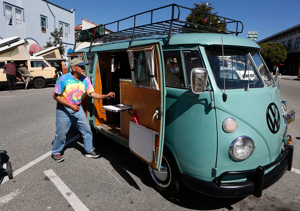 . Charlie Garcia of Vancouver, WA opens up his 1964 Volkswagen E-Z Camper Van at the begining of the Treffen 19 VW Cruise Show & Shine in Downtown Pacific Grove, Calif. on Wednesday July 26, 2017. Garcia said he joined Canadians as they crossed into the U.S. on the 19th Annual cruise from Canada to Mexico. He has owned the vehicle since 1976. (David Royal/Herald Correspondent)